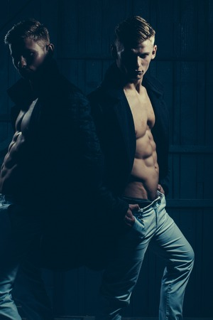 strip shirt: Two young men with sexy body showing their muscular torso and abs in open shirts