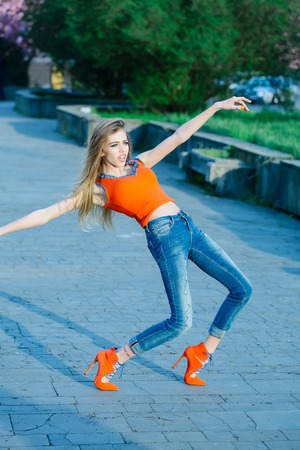 outstretched: girl running jumping carefree with outstretched hands Stock Photo