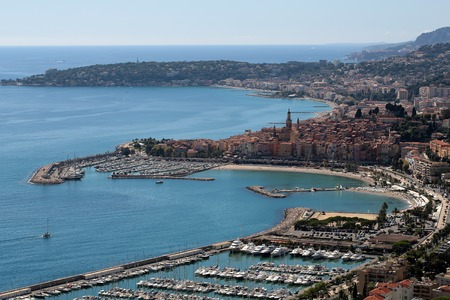 blue vessels: Monte Carlo, Monaco - September 21, 2015: city port beautiful modern vessels at moorage in yacht club panoramic view day time blue skyline on seascape background