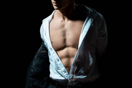 open shirt: young handsome gentleman wearing fashion black suit in white open shirt with bare torso Stock Photo