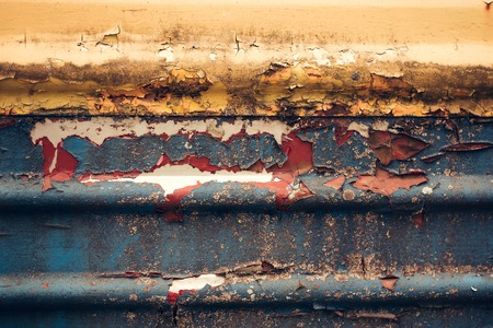 ferruginous: Multicolored background: rusty metal surface with paint flaking and cracking texture