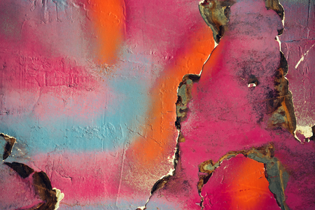 colored dye: Multicolored background: bright stony surface with paint flaking and cracking texture