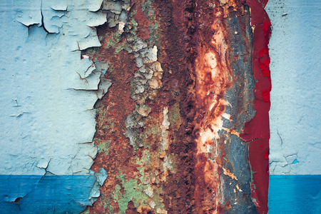 crackles: Multicolored background: rusty metal surface with blue paint flaking and cracking texture Stock Photo