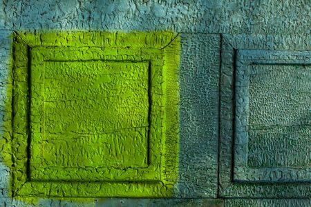 metallized: Metal wall yellow and blue paint with old cracks on metallized background Stock Photo