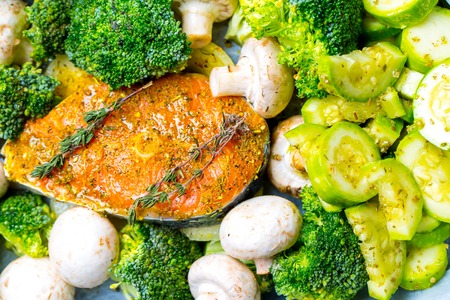champignons: Salmon steak fresh raw fish with champignons broccoli spices and rosemary vegetables for cooking