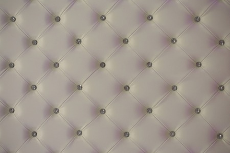 padding: Buttoned white leather wall with vignetting on padding background