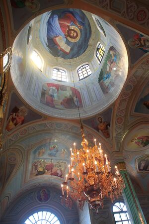 cutglass: Beautiful paintwork on church walls and cut-glass chandelier high in ceiling