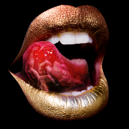 licking tongue: sexual female golden lips with licking tongue and white teeth isolated on black background combined with overlay of muscular man with bare torso, double exposure