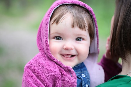 small cute baby girl with pretty smiling face and funny eyes stock