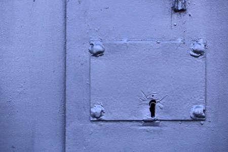 eye hole: Metal key hole on the iron door Stock Photo
