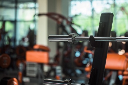 weightlifting equipment: diverse equipment and machines at the gym room for sport training and weightlifting, closeup Stock Photo