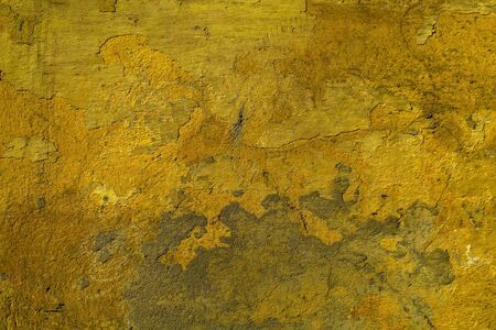 roughcast: Old yellow dirty uneven weathered cement wall texture background