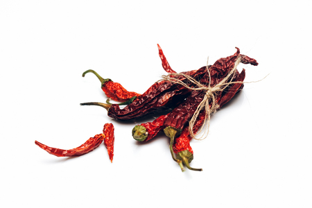 chilli pepper: dried red wrinkled chilli pepper or capsicum in rope isolated on white background, copy space