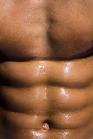 sixpack: sexy muscular male torso six packs on wet body of athletic man training with bare strong chest, closeup