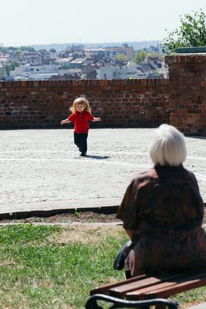 Baby boy on the walk with his grandmother Zdjęcie Seryjne - 113575461