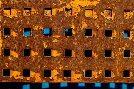 perforated: Plate metallic rusty with square holes slots perforated sheet shield screen on metallized background