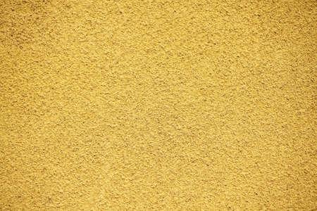ochre: Rugged plaster wall on ochre background Stock Photo