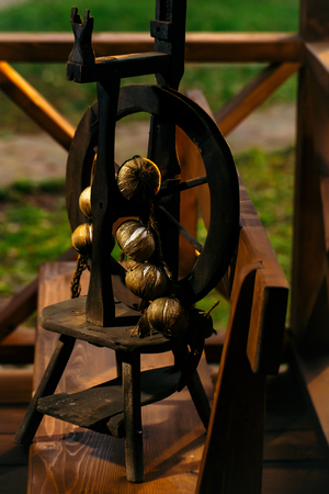 buch: Miniature spinning wheel with brown onion bunch Stock Photo