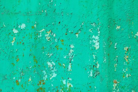 metallized: Rusty metal surface with old green paint cracks and peels on metallized background Stock Photo