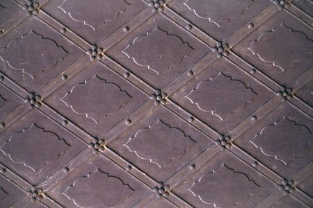 metallized: Old iron door fragment with decoration on metallized background