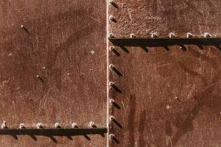 metallized: Metal rusty panel with rivets on metallized background