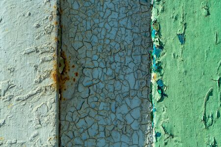 metallized: Rusty metal surface with old blue paint cracks and peels on metallized background Stock Photo