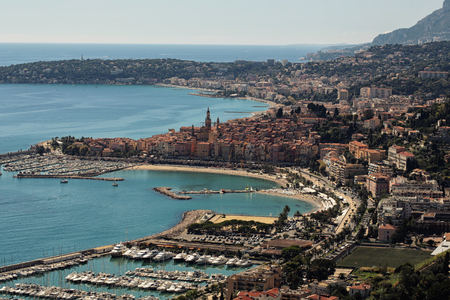 blue vessels: Monte Carlo, Monaco - September 21, 2015: beautiful city port modern vessels at moorage in yacht club panoramic view day time blue skyline on seascape background