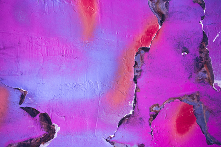 crackles: Multicolored background: bright stony surface with paint flaking and cracking texture