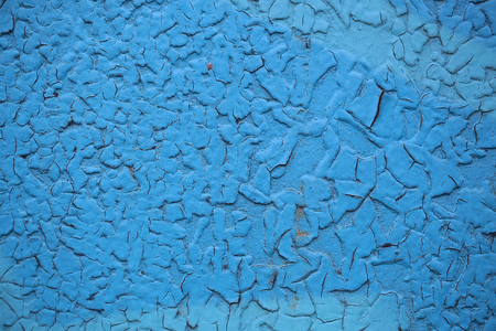 surface aged: Cracked paint coat layer on iron sheet plate screen aged grungy rough surface with rusty spots damaged on blue background