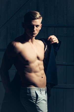 sexi: Young man with sexy body showing his muscular torso and abs in open jacket Stock Photo