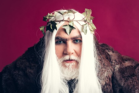 jupiter: Zeus god man or jupiter with crown on long hair with beard Stock Photo