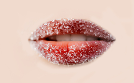 provocative woman: Close up of red lips covered in shugar