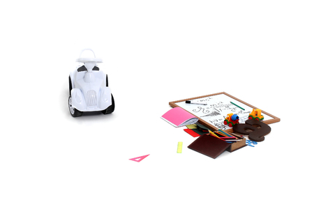 note board: Plastic car toy note board wooden box with colored pencils colorful rulers triangle alphabet and exercise book and other school stationery on white background isolated Stock Photo