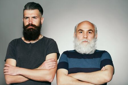 white beard: Old and young bearded men with long beard white and brown in studio on grey background