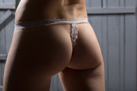 Woman beautiful buttocks in white lingerie closeup Stock Photo