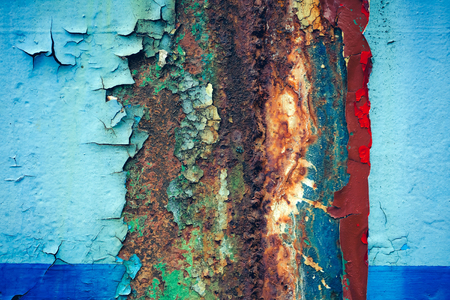colored dye: Multicolored background: rusty metal surface with blue paint flaking and cracking texture Stock Photo