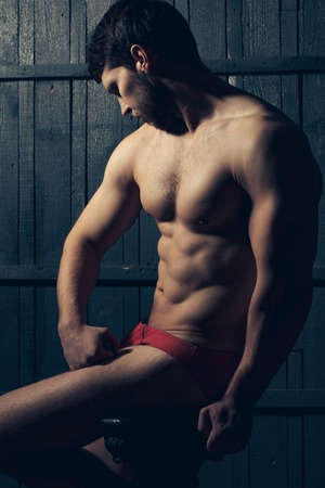 masculinity: Handsome muscular man in red panties