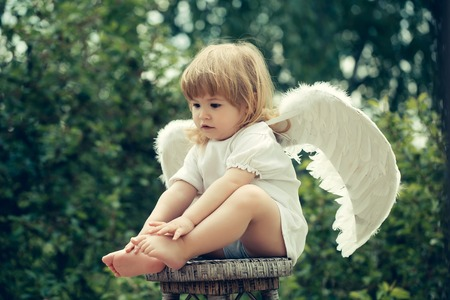 Cute little cupid just landed on a chair