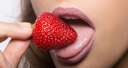 Sexy Female Mouth With Pink Lipstick On Lips Eating And Licking With Tongue Red Sweet Strawberry