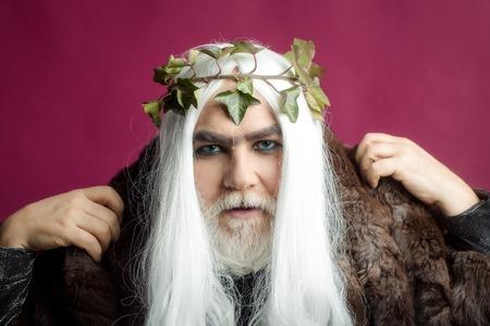 metaphysics: Zeus god or jupiter with vine crown in studio Stock Photo