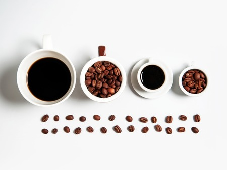 cup four: four white cups of coffee drink or beverage with roasted brown beans in line isolated on white background