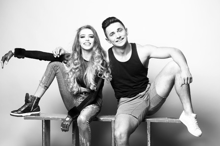 sexual relations: Stylish couple. Shot of a fashionable couple posing at studio, black and white