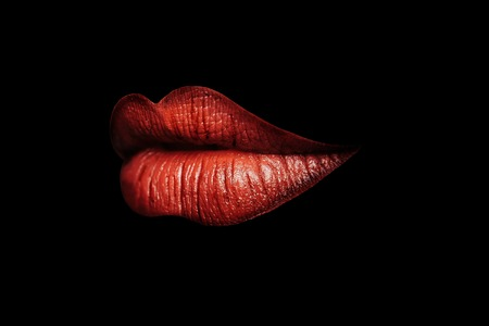 gloss: sexy beautiful female closed lips or mouth red color with gloss or lipstick isolated on black background Stock Photo