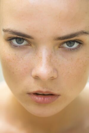 soft skin: young girl model with freckles on pretty face with soft skin outdoor, closeup Stock Photo