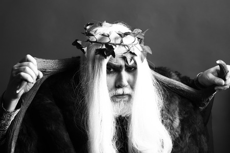 Zeus god man or jupiter with antlers and vine crown on long hair with beard, black and white