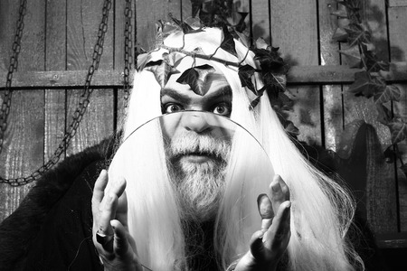 metaphysics: Zeus god or jupiter with magnifying glass, black and white