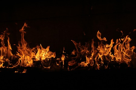 Fire line on black background. Abstarct burning flame.