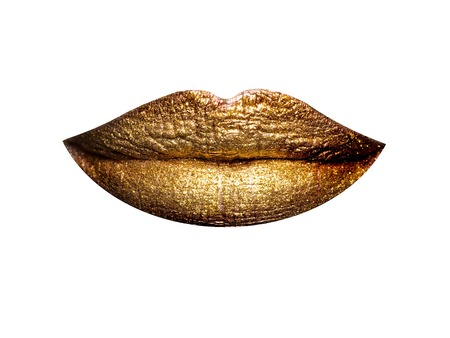 coloring lips: sexy female golden or gold lips isolated on white background as makeup or body art painted mouth metallized color