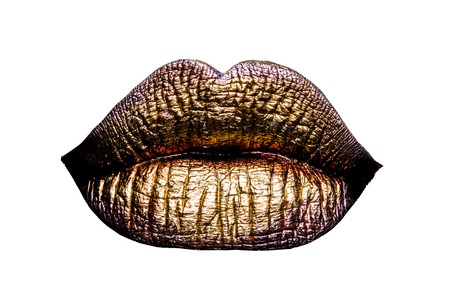 metallized: sexy female golden or gold lips isolated on white background as makeup or body art painted mouth metallized color with violet contour