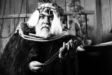 Zeus god or jupiter in rope with vine crown in studio, black and white Stock Photo
